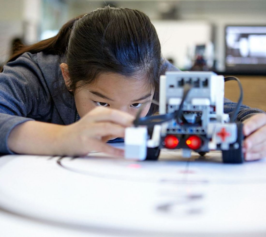 Girl building a robot